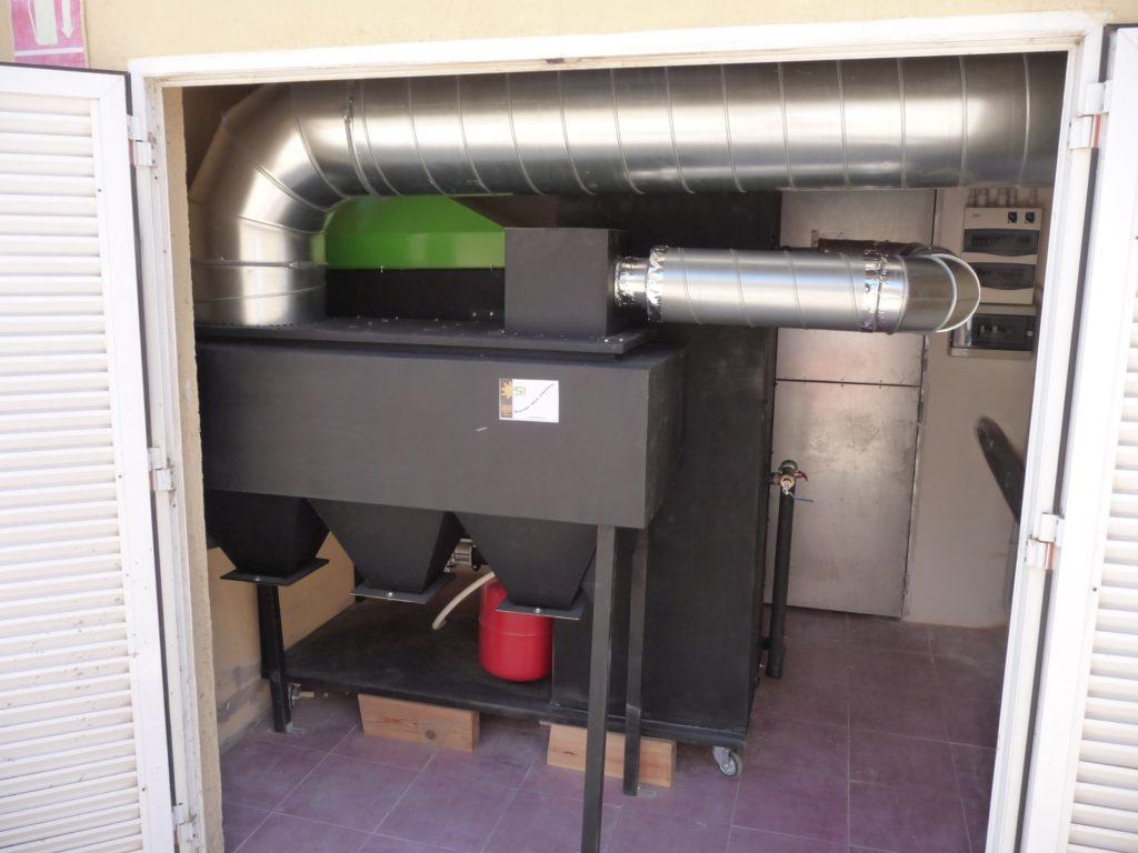 Instalación caldera biomasa de 35 kW + filtro de partículas.